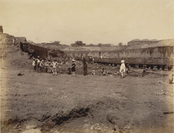 The second basin, looking due west, stump of teak tree in situ, found under sea bottom [Victoria Dock construction, Bombay]..